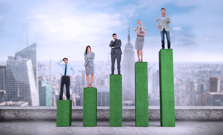 Composite image of business people standing on bar chart depicting growth photo
