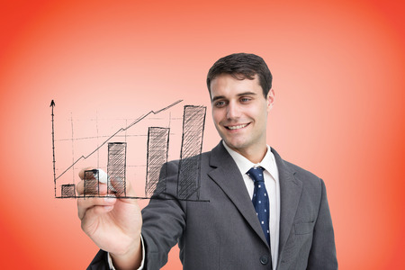Composite image of businessman drawing graph against orange photo