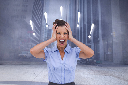 Stressed businessswoman with hand on her head against urban projection on wall photo