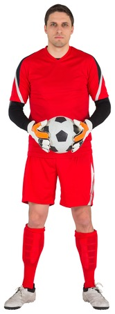 goal keeper: Fit goal keeper looking at camera on white background