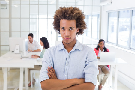 Stern worker with arms crossed in the office photo