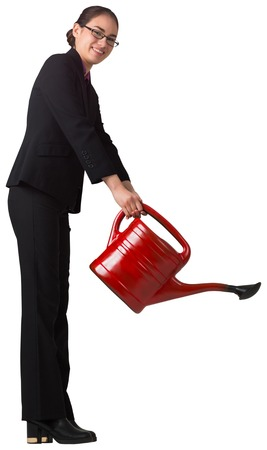 Businesswoman using red watering can on white background photo