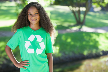 Young environmental activist smiling at the camera on a sunny day photo
