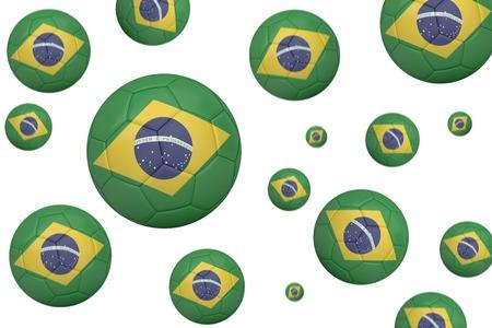 Footballs in brasil flag colours on white background photo