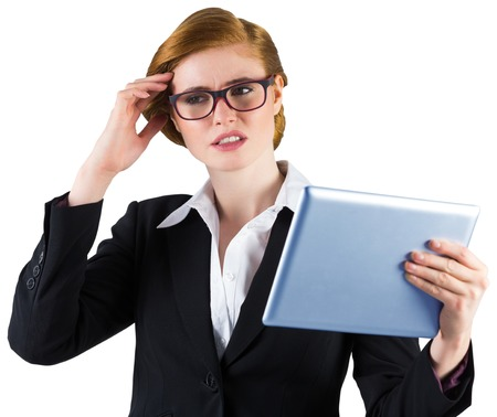 Redhead businesswoman using her tablet pc on white background photo