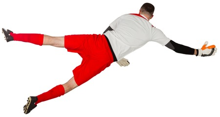 goal keeper: Fit goal keeper jumping up on white background