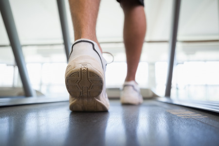 Man walking on the treadmill at the gym photo