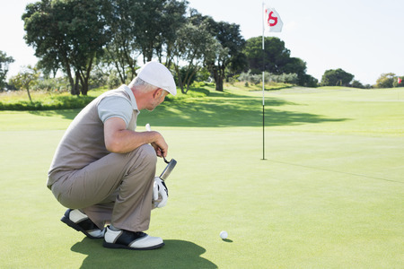 eighteenth: Golfer on the putting green at the eighteenth hole on a sunny day at the golf course Stock Photo