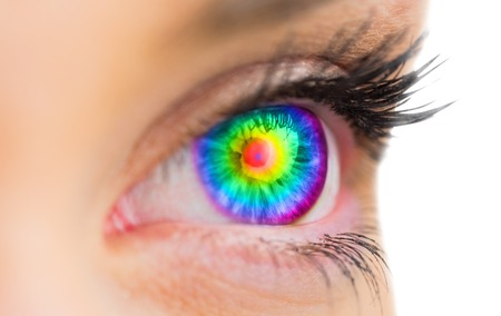Psychedelic eye looking ahead on white background photo