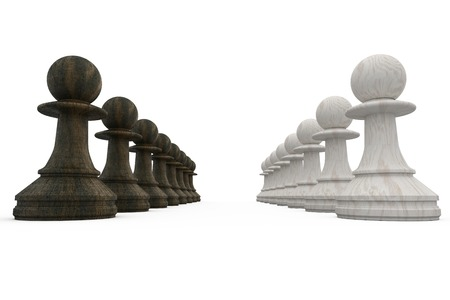 face off: Black and white pawns facing off on white background