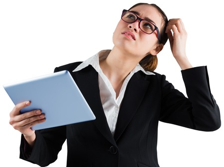 Thinking businesswoman looking at tablet pc on white background photo