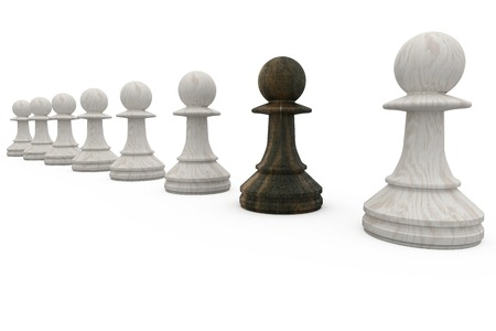 Black pawn standing with white pawns on white background Stock Photo