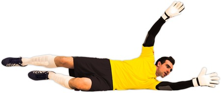 making a save: Goalkeeper in yellow making a save on white background Stock Photo