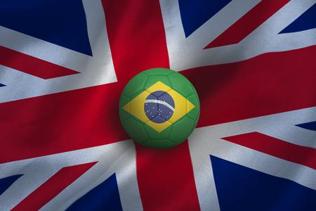Football in brasil colours against union jack flag background photo
