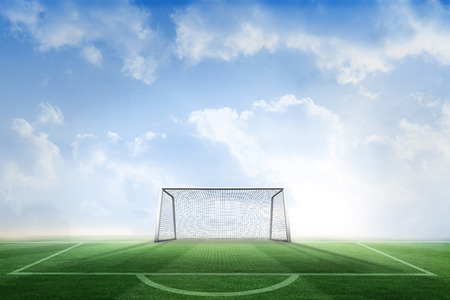 goalpost: Digitally generated football pitch and goal under blue sky
