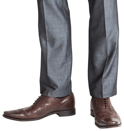 brogues: Businessmans feet in brown brogues on white background