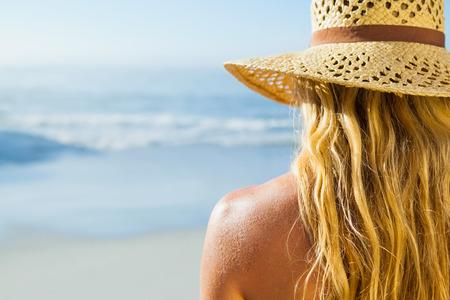 beach blond hair: Gorgeous blonde in sunhat on the beach on a sunny day
