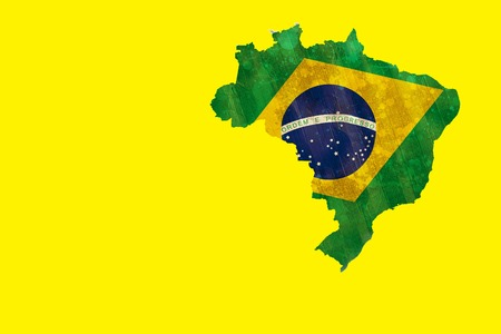 grimy: Digitally generated green brazil outline with flag on yellow