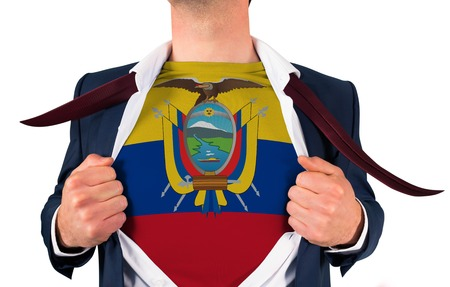 Businessman opening shirt to reveal ecuador flag on white background photo