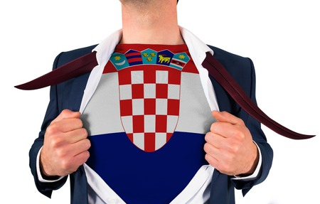 Businessman opening shirt to reveal croatia flag on white background photo
