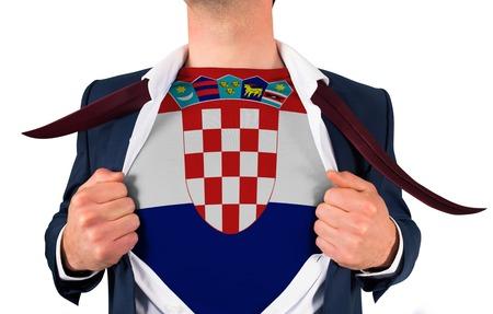 Businessman opening shirt to reveal croatia flag on white background photo