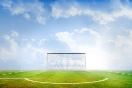 digitally  generated: Digitally generated football pitch under blue sky Stock Photo