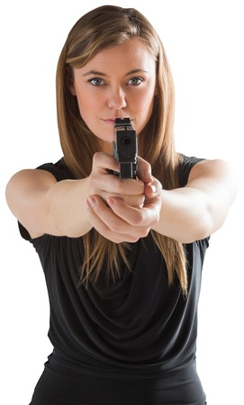 Femme fatale pointing gun at camera on white background photo