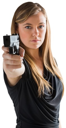Femme fatale pointing gun at camera on white background Imagens - 28986398