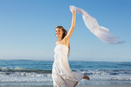 maxi dress: Beautiful blonde in white sundress on the beach with cocktail on a sunny day Stock Photo