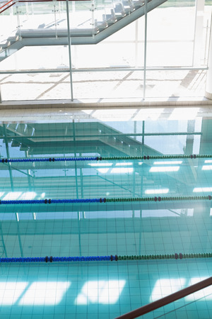lane marker: Large swimming pool with sunlight streaming in at the leisure center