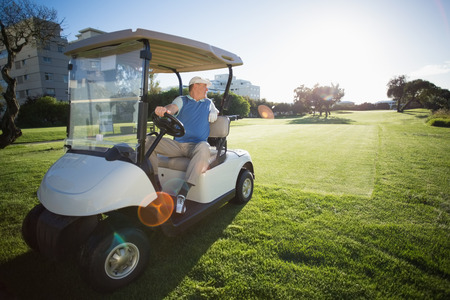reversing: Golfer reversing his golf buggy on a sunny day at the golf course