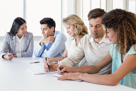Casual business team having a meeting in the office photo