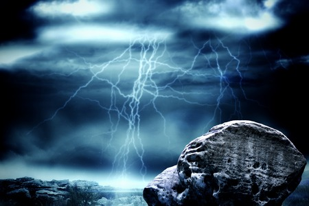 stormy sky: Digitally generated large rock overlooking stormy sky