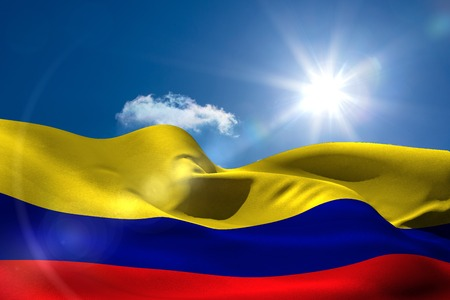 Digitally generated colombia national flag under sunny sky photo