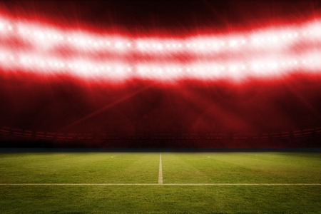 digitally  generated: Digitally generated football pitch under red lights Stock Photo
