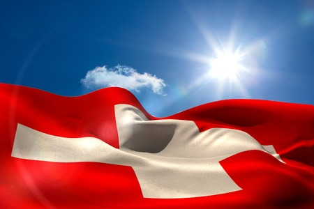 swiss flag: Digitally generated swiss flag rippling against blue sky