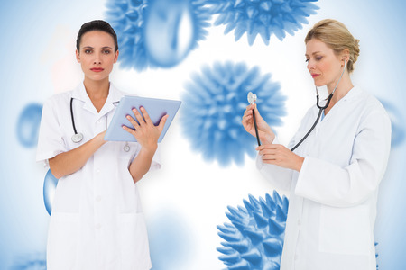 Composite image of female medical team against blue virus cells photo