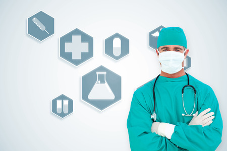 Portrait of an ambitious surgeon against blue medical interface with icons photo