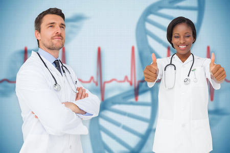 Composite image of happy medical team against blue medical background with dna and ecg photo