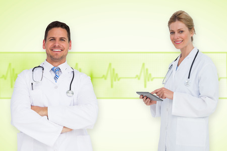 Composite image of happy medical team against medical background with green ecg line photo