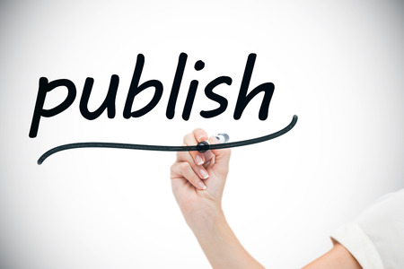 Businesswoman writing the word publish against white background with vignette