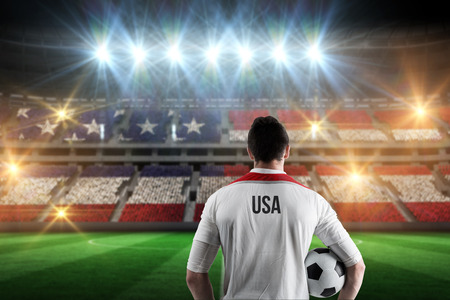 world cup: Usa football player holding ball against stadium full of usa football fans