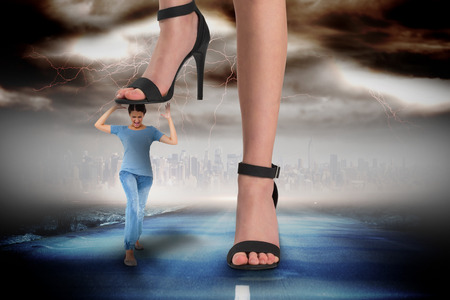 Composite image of female feet in black sandals stepping on girl against stormy sky with tornado over road