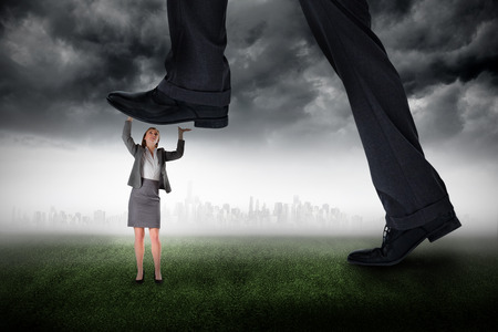 all weather: Composite image of businessman stepping on tiny businesswoman against city on the horizon