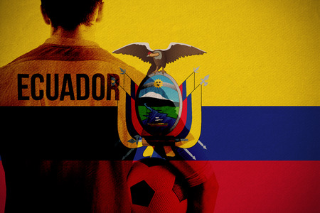Ecuador football player holding ball against ecuador national flag photo