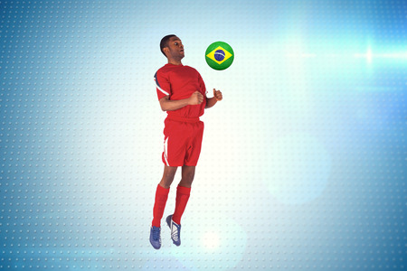 Football player in red jumping against technical screen with pixels  photo