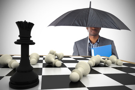 pawn adult: Composite image of businessman standing under umbrella with chessboard