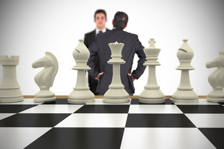 pawn adult: Composite image of businessmen and chess pieces against white background with vignette