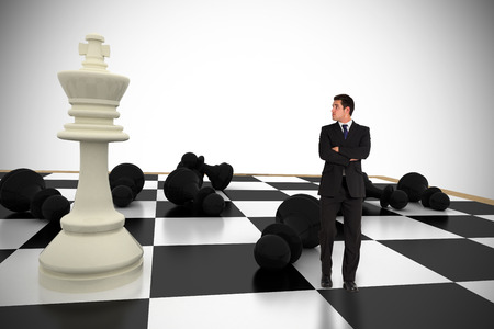 pawn adult: Businessman standing and looking with chessboard against white background with vignette Stock Photo