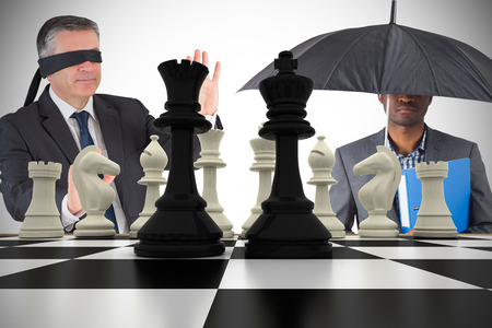 Composite image of businessmen with chessboard against white background with vignette photo